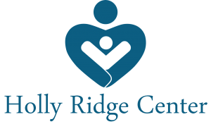 """Holly Ridge Center Logo: All text that reads: """"Holly Ridge Center"""" with a dark blue, heart-shaped person holding a smaller, white person in their arms."""
