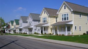 Image: Row of similar looking houses on a residential street.
