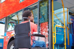 Image: Woman using a wheelchair boarding a bus